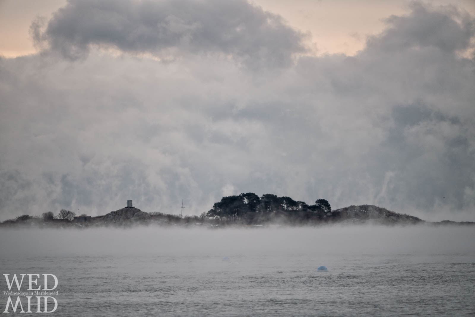 Childrens Island appears surrounded by sea smoke on an arctic morning in December
