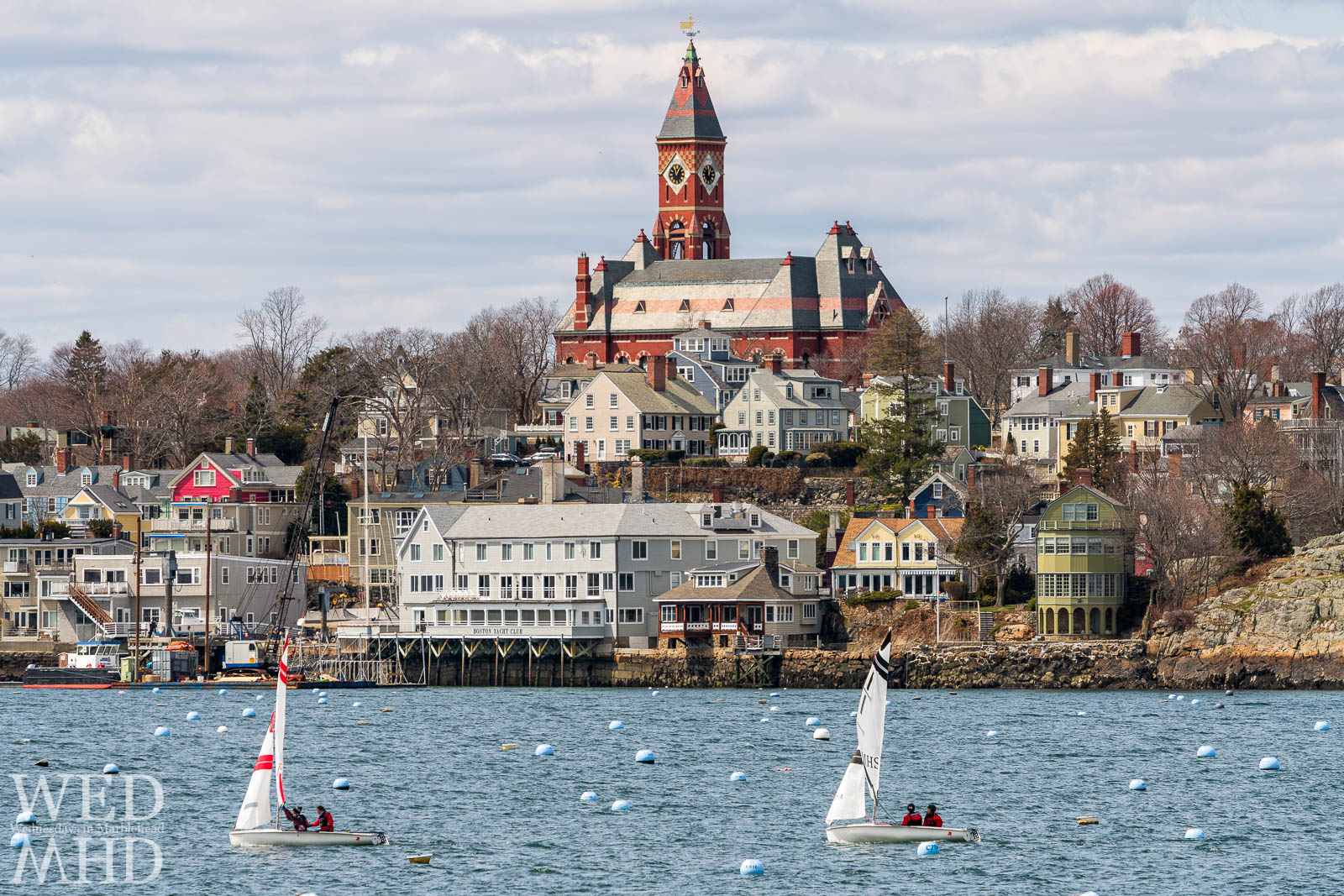 Frostbite sailing takes place on a beautiful sunday in April with Marblehead harbor yet to fill with boats for the season