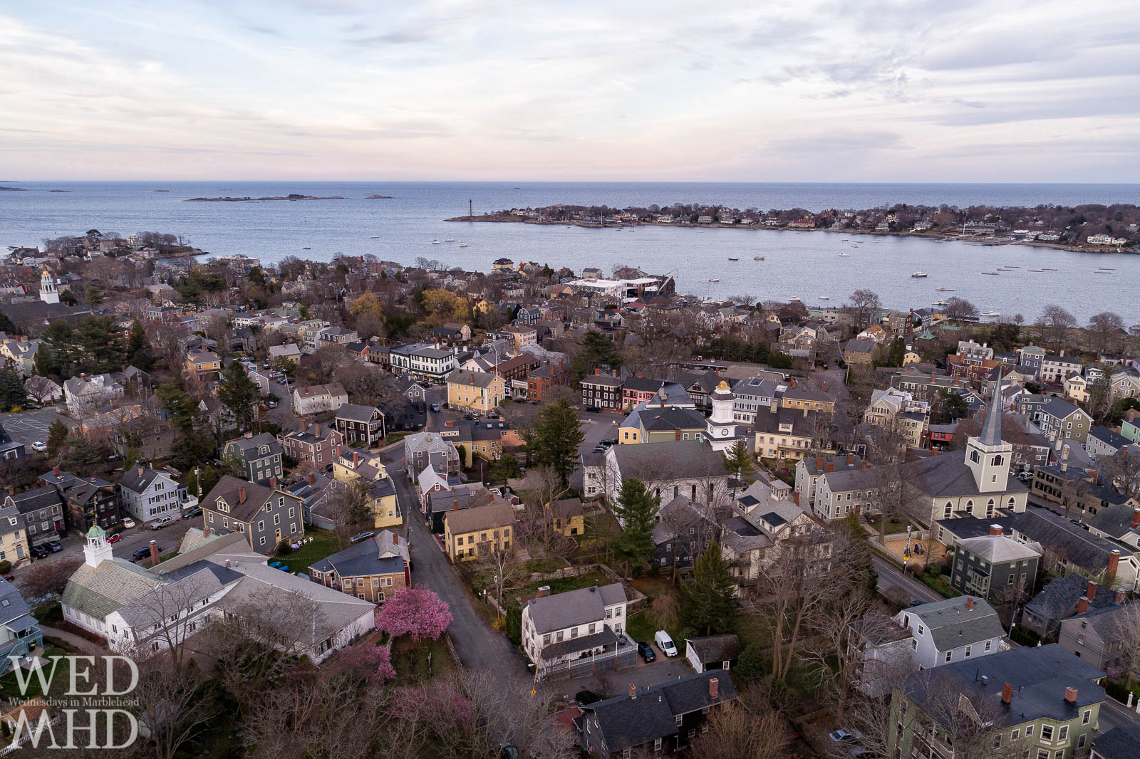 A hint of pink cherry blossoms is the first sign of spring on this April evening over Marblehead