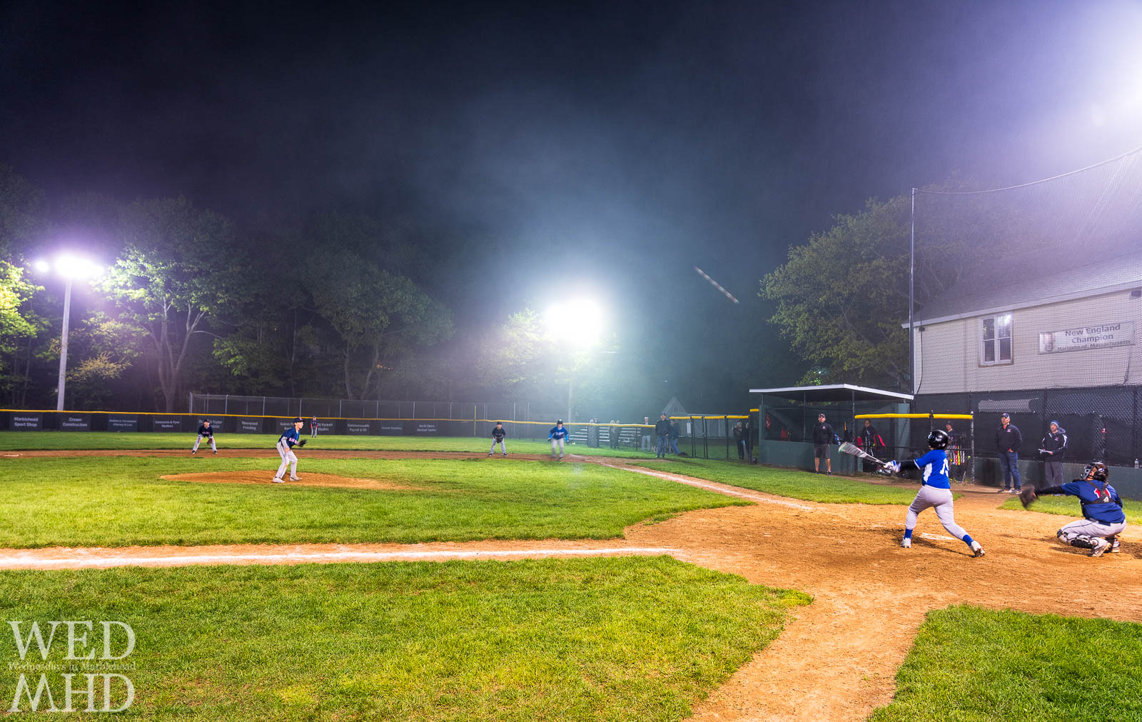 Kids playing baseball in the fog at Gatchells Field with a shot into centerfield scoring a run