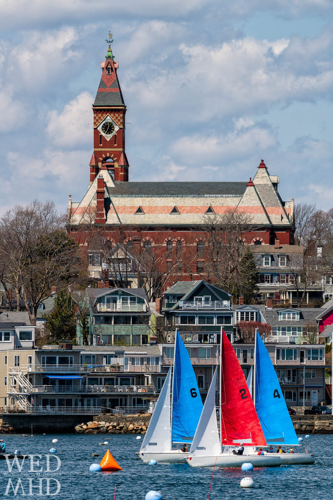 One design boats compete for the Jackson Cup in front of Abbot Hall on a perfect April afternoon