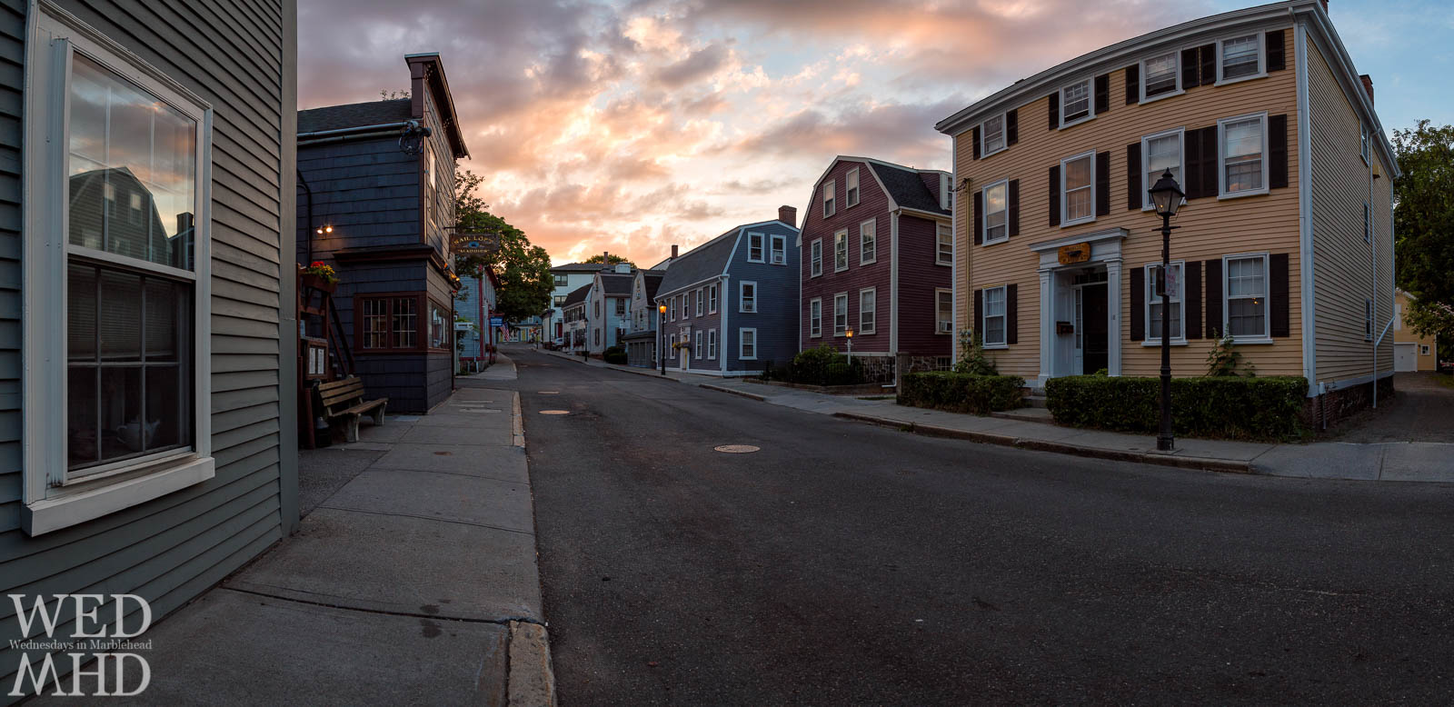 Sunset light paints the houses of State Street in a soft glow on this June evening