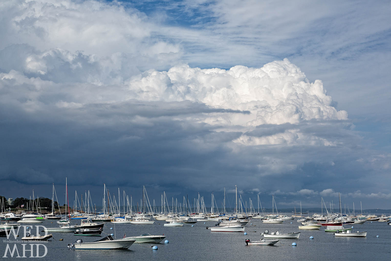 A cumulonimbus cloud forms over Marblehead Harbor ahead of an oncoming storm. The cloud would be followed by an impressive shelf cloud.