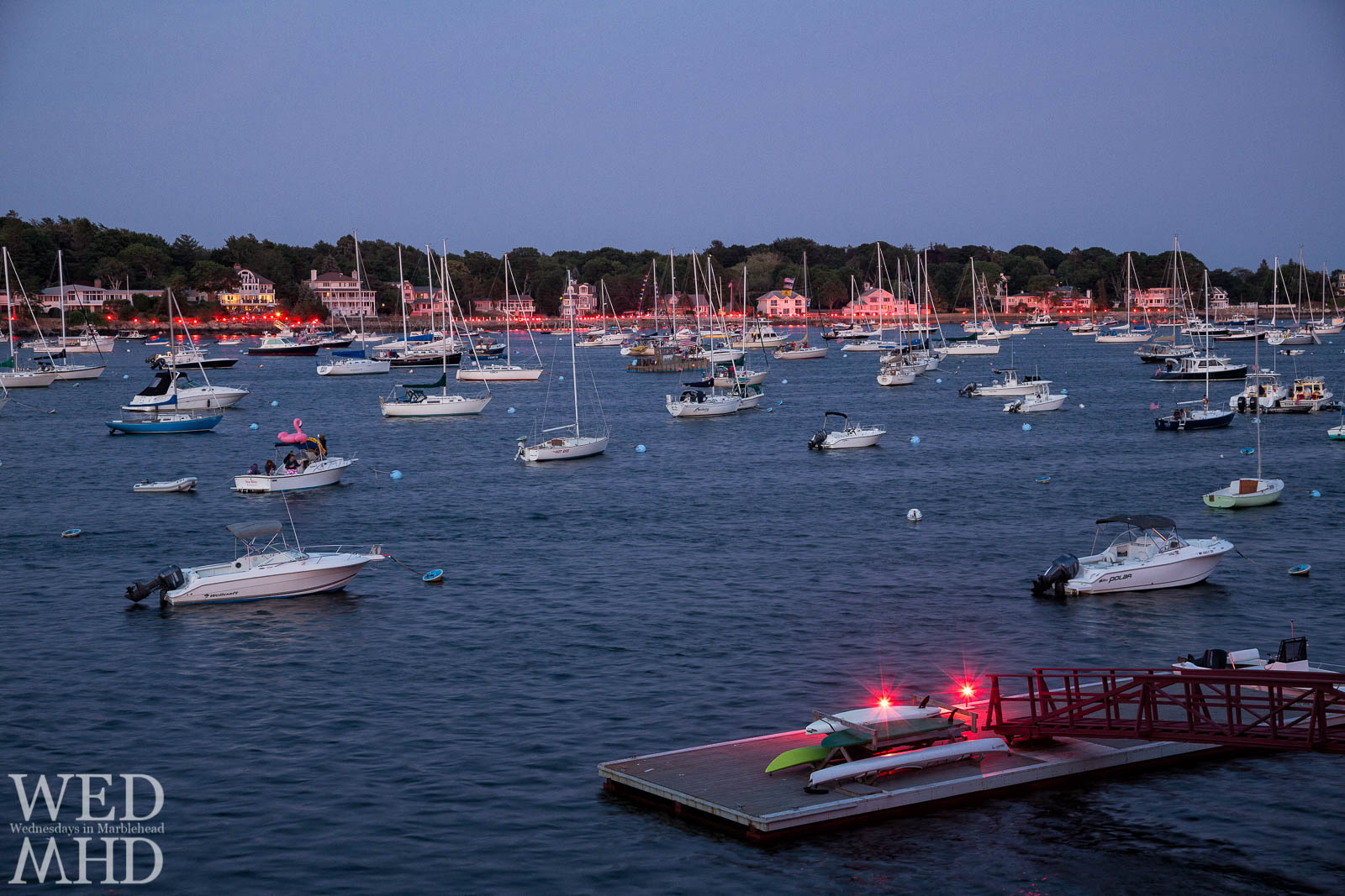 The annual Harbor Illumination takes place on the Fourth of July with lit flares around the harbor setting the scene for the fireworks show