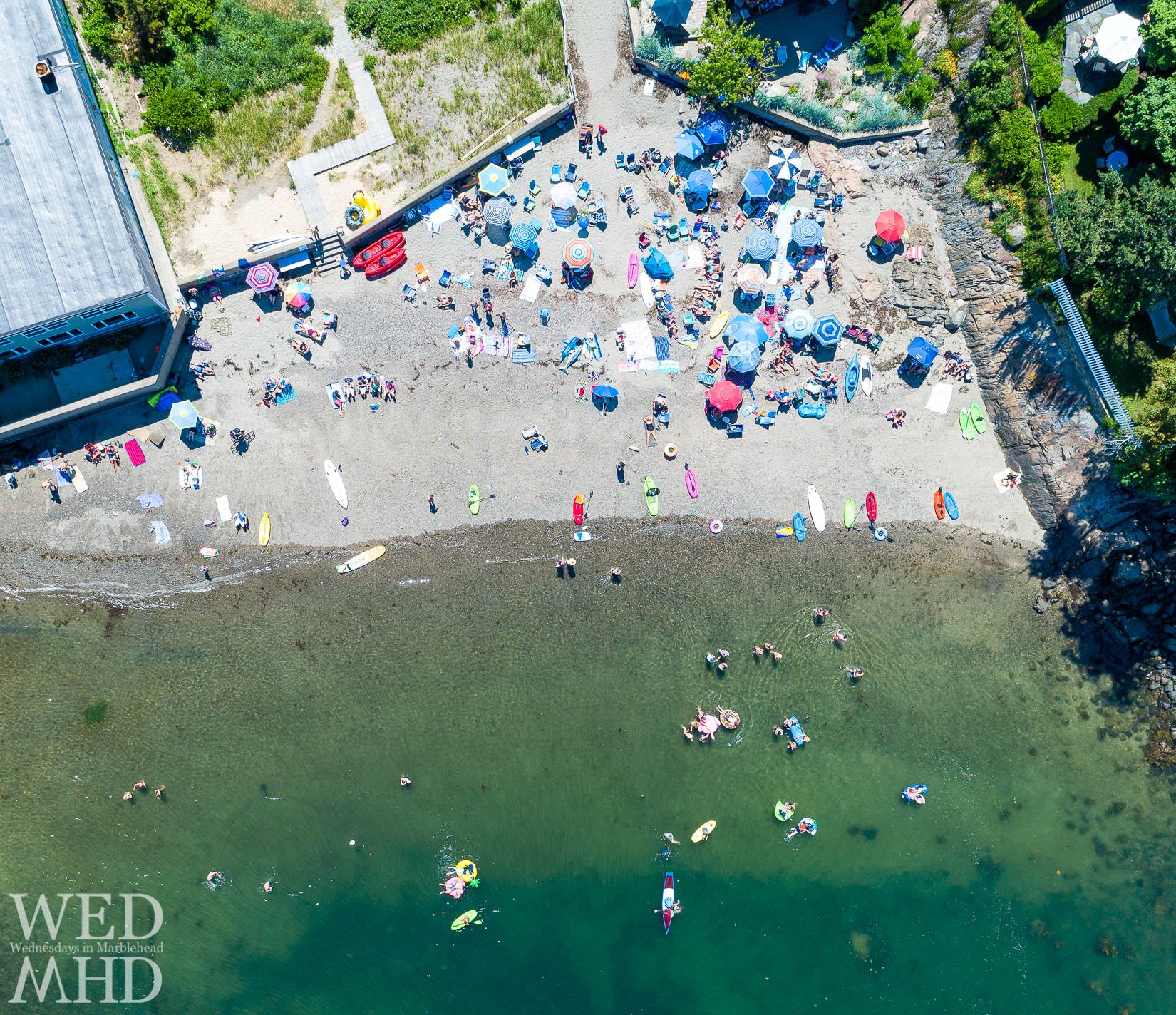 Aerial view of people at Gas House Beach enjoying the water on the Fourth of July in Marblehead