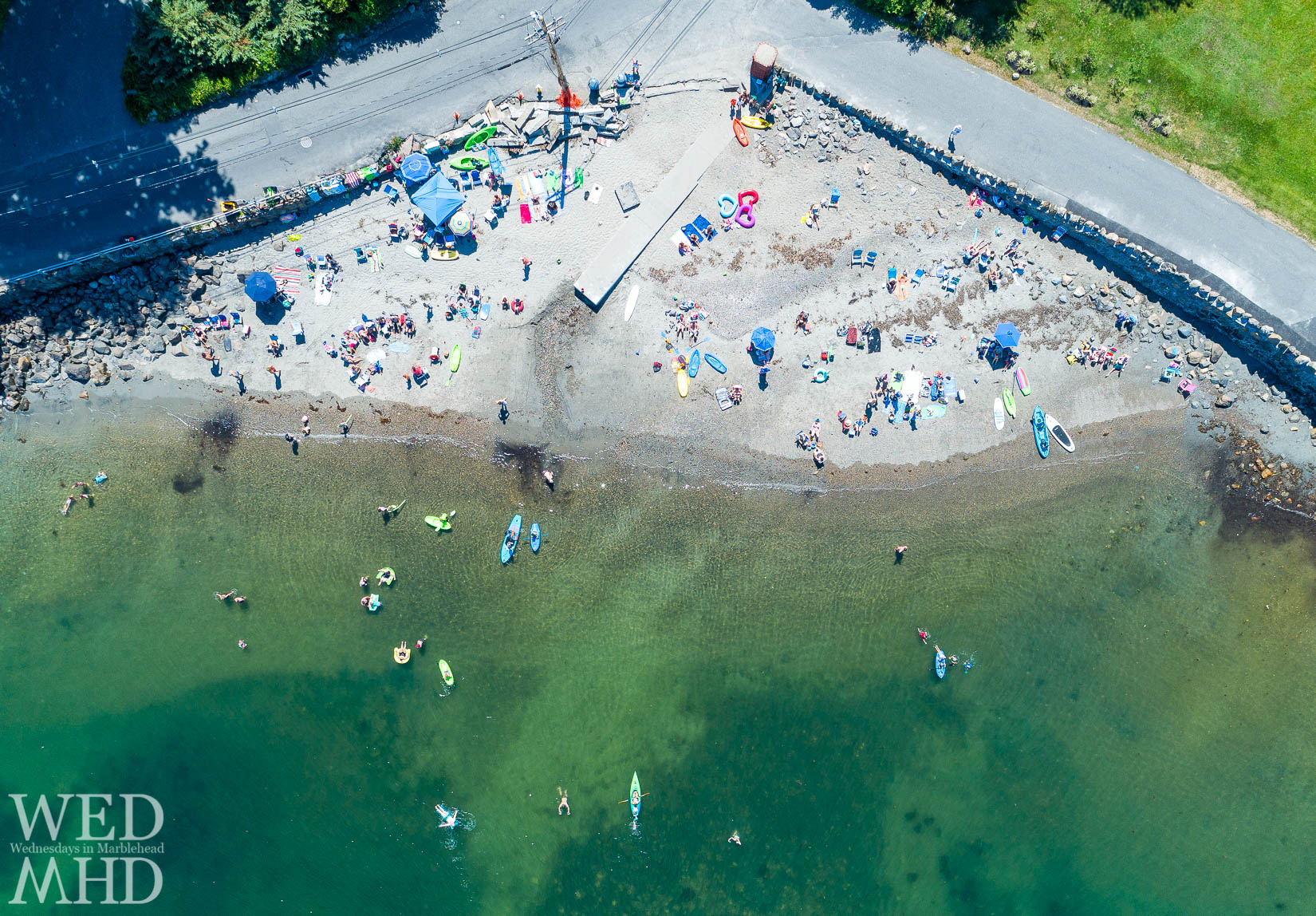 Aerial view of people at Grace Oliver Beach enjoying the water on the Fourth of July in Marblehead