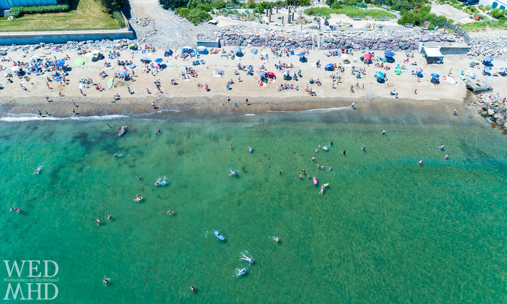 Aerial view of people at Preston Beach enjoying the water on the Fourth of July in Marblehead