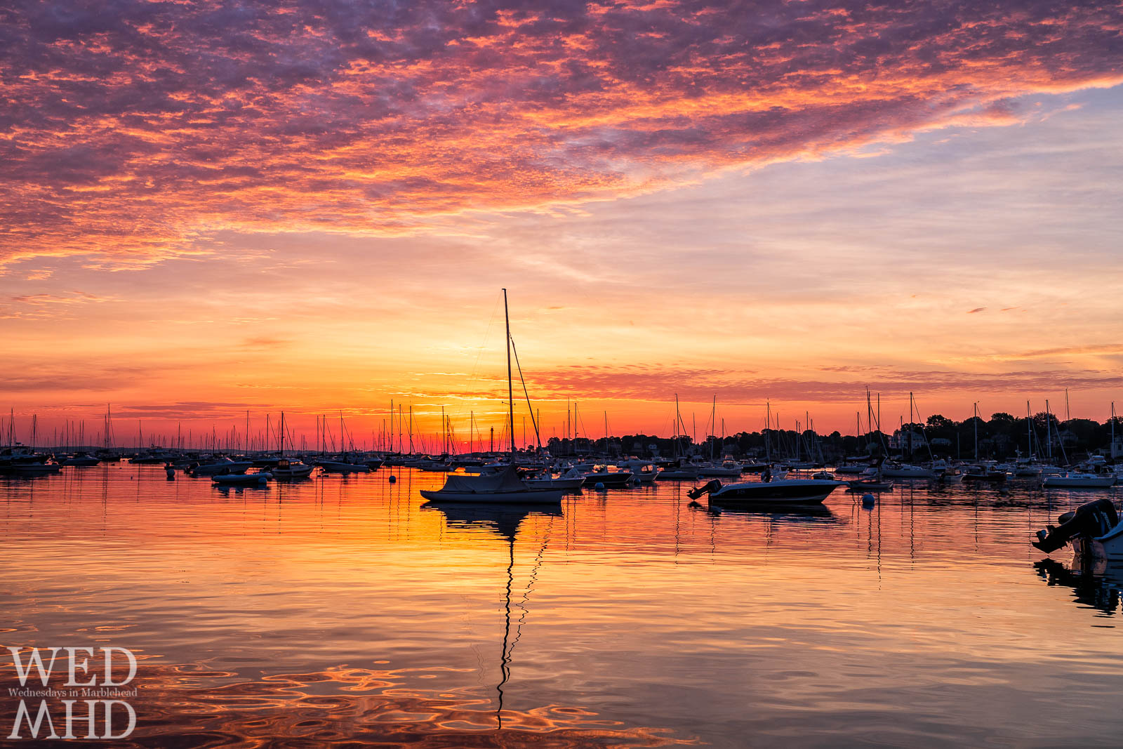 In late June a sunrise bathed Marblehead harbor in a range of colors and seemed to last forever
