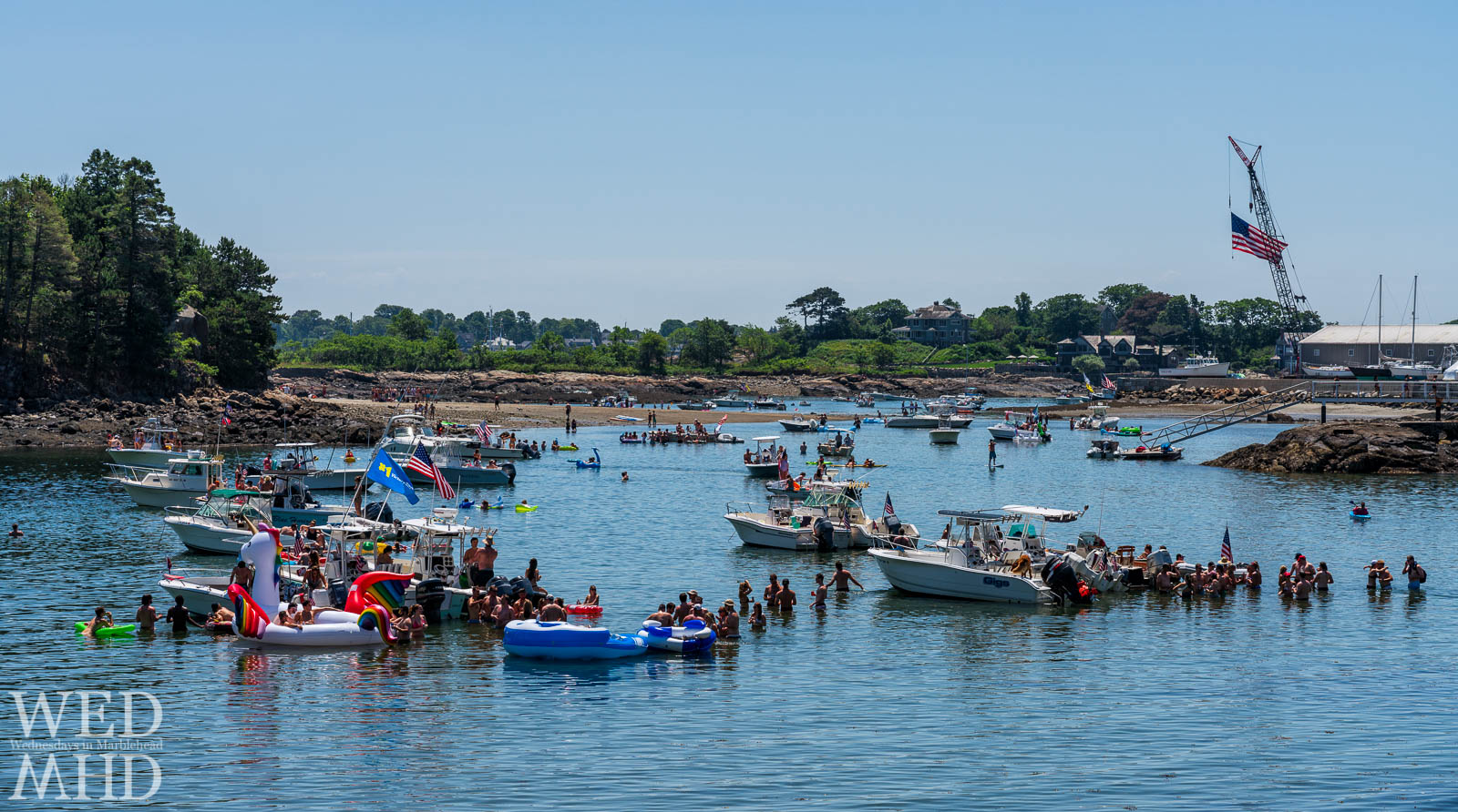Boats are tied up in Little Harbor as people celebrate the Fourth of July