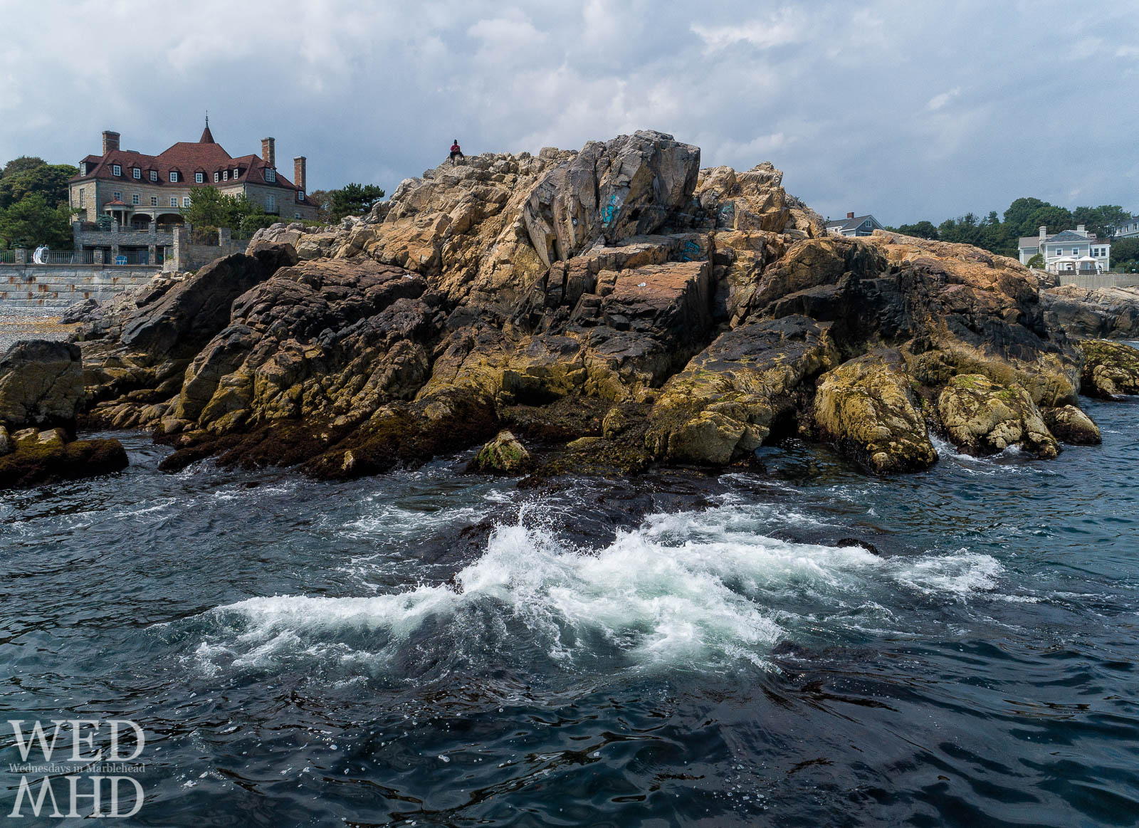 An aerial image captured a few feet above the waves at Castle Rock captures the iconic location from a new perspective