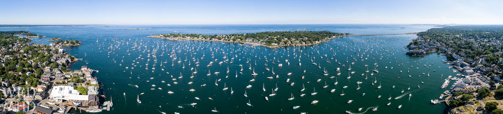 A full harbor is captured in this aerial panorama taking in the whole of Marblehead Neck on the Fourth of July