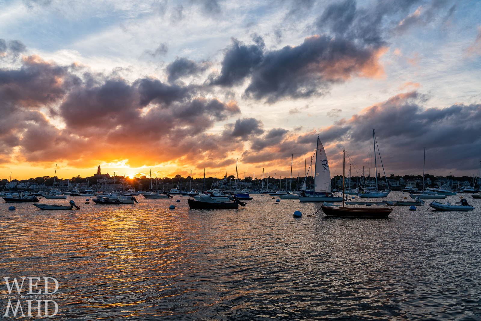 There really is nothing better than a Marblehead sunset - made even more beautiful with a full harbor and a sailboat just reaching its mooring