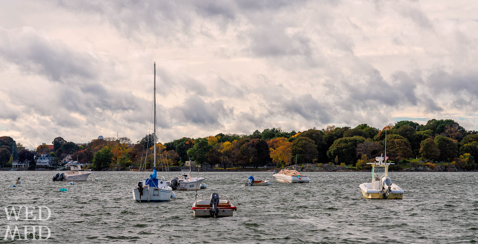 Fall color can be seen across Salem Harbor with boats still moored in the waters as autumn begins to take shape in Marblehead