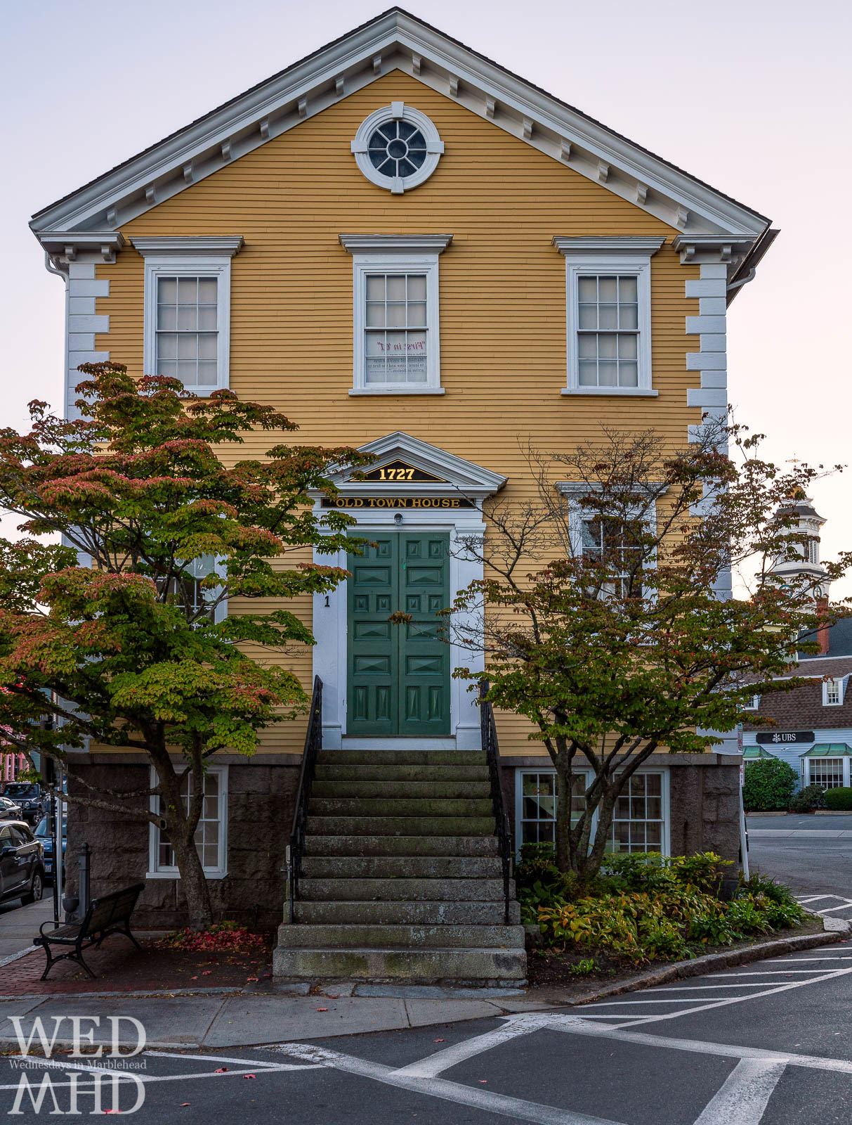 Trees in front of Old Town House begin to change color signaling the arrival of autumn in Marblehead