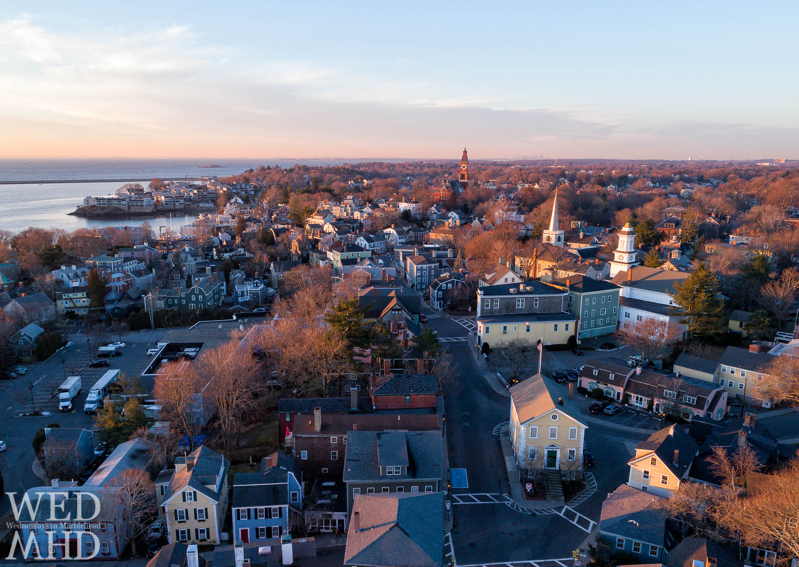 The warm glow of the morning sun bathes Washington Street as seen from 100 feet above the town of Marblehead