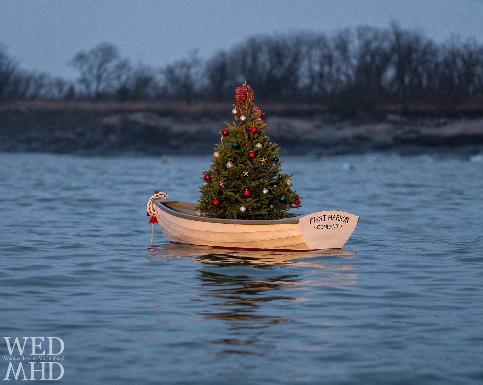 The First Harbor company boat holds a perfectly decorated Christmas tree in the waters of little harbor in Marblehead