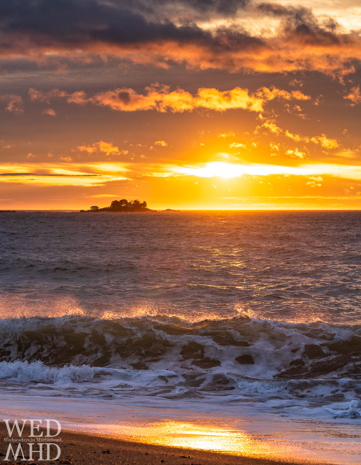 Breaking waves captured with the backlight of sunrise on New Years Day at Devereux Beach in Marblehead