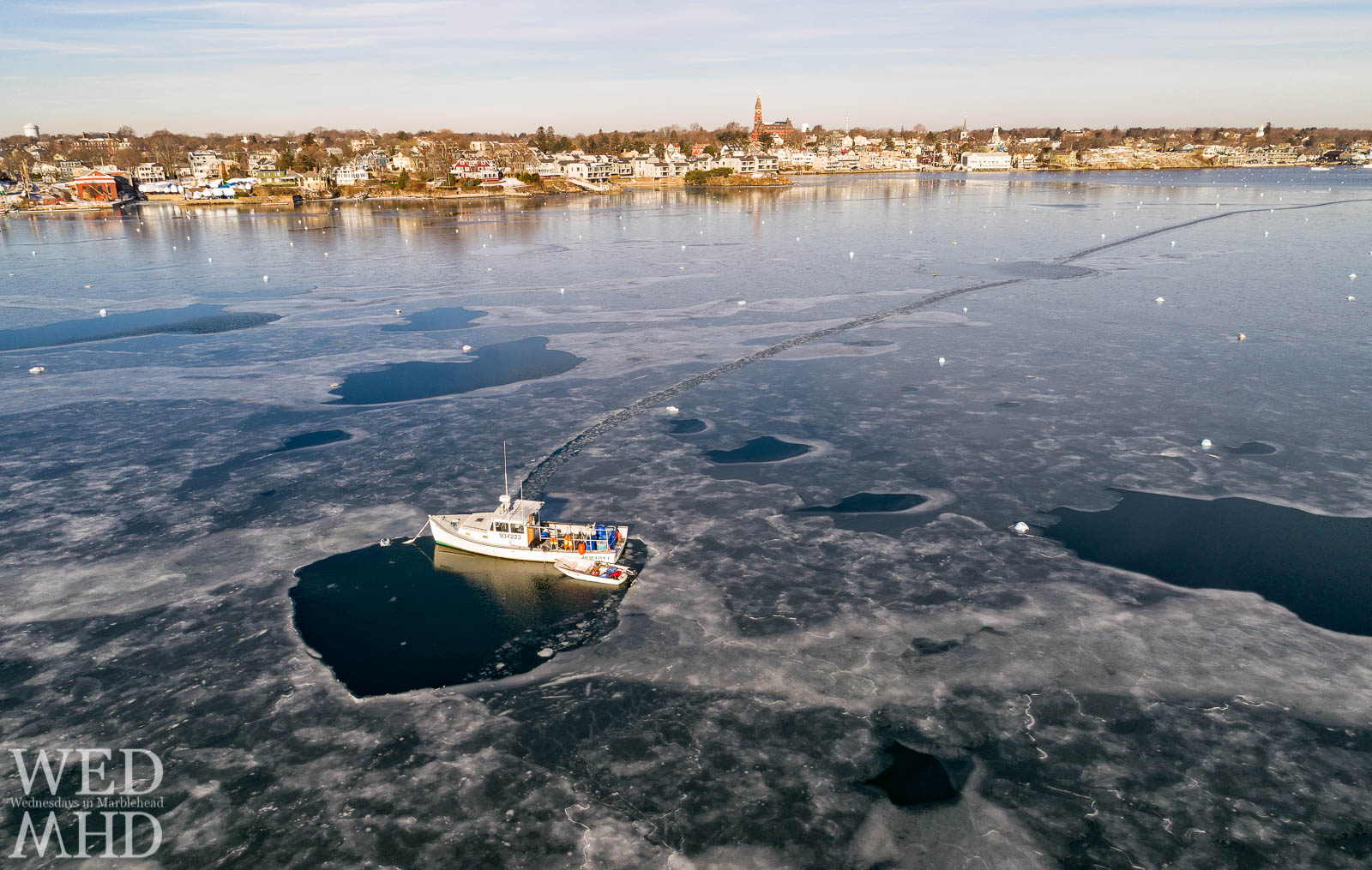 Two boats are iced in during an arctic cold snap that froze parts of Marblehead Harbor