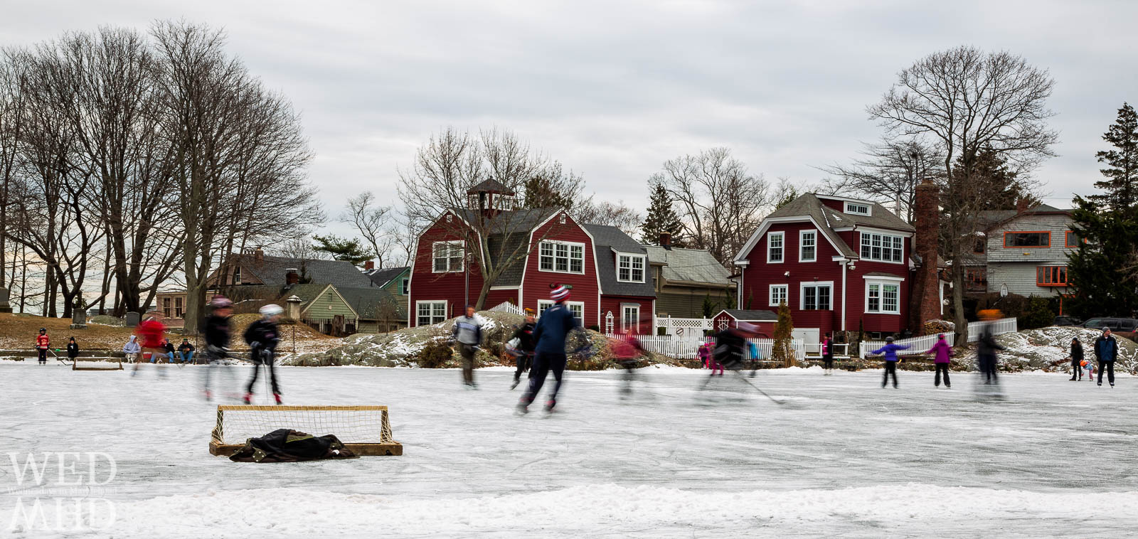 Kids and adults enjoy pond skating as well as a pickup hockey game on a frozen Redds Pond in Marblehead