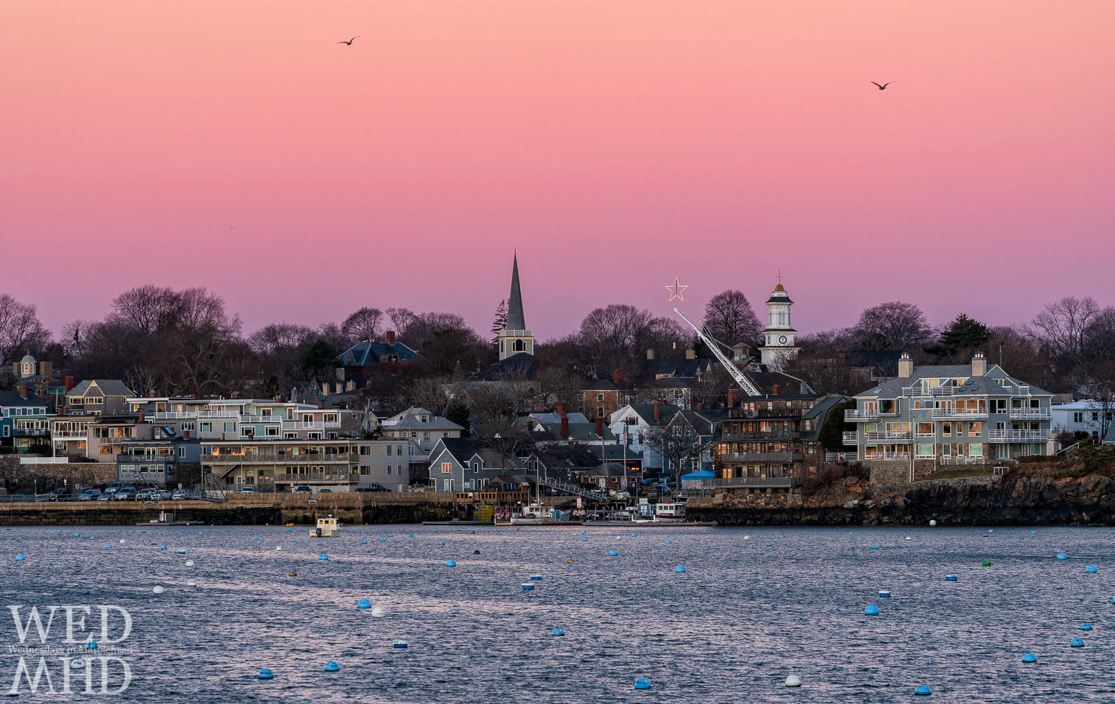 The shining star atop a crane at the State Street Landing is perfectly positioned between St. Michaels and Grace Community Church in this sunrise image
