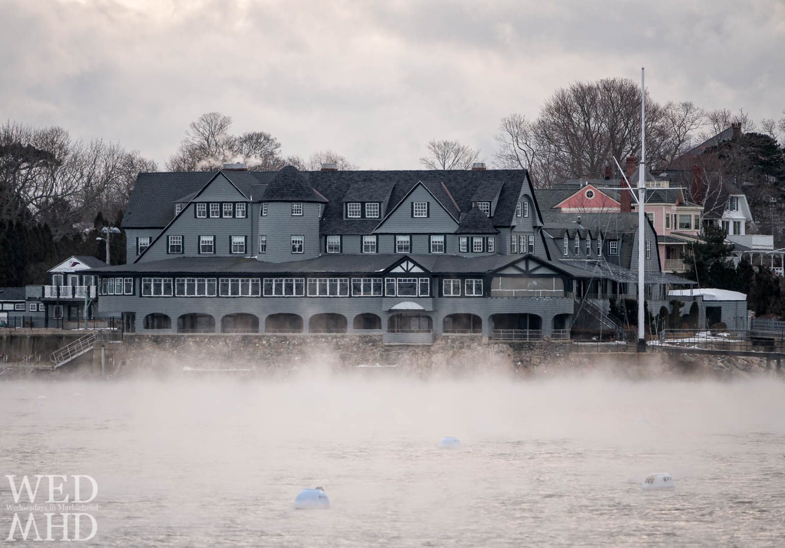 Sea smoke forms inside Marblehead Harbor and in front of the Corinthian Yacht Club on an arctic morning in December
