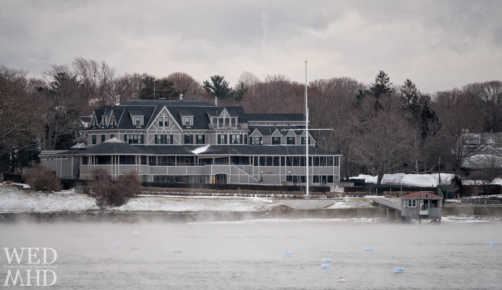 Sea smoke forms inside Marblehead Harbor and in front of the Eastern Yacht Club on an arctic morning in December