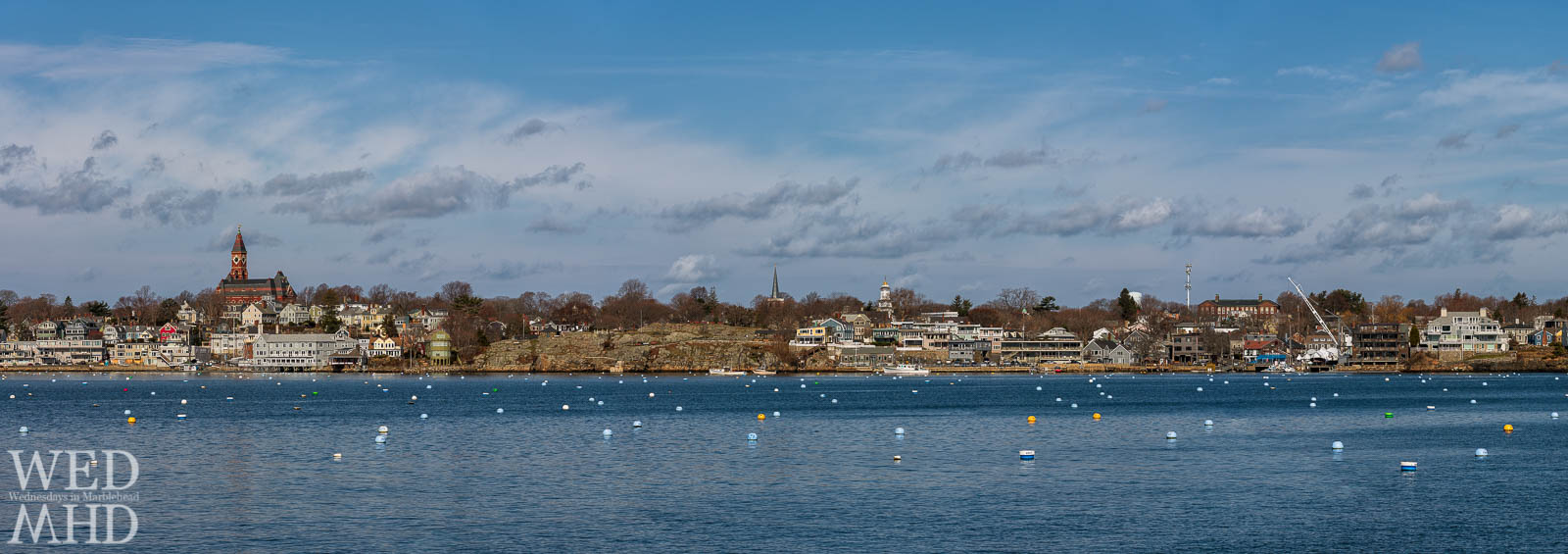 A panoramic view of an empty Marblehead Harbor spans from Abbot Hall to the State Street Landing