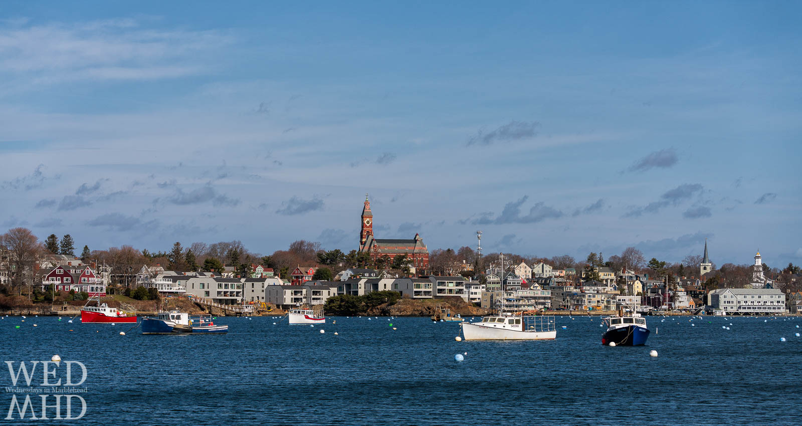 Five working boats fill the otherwise empty moorings in Marblehead Harbor