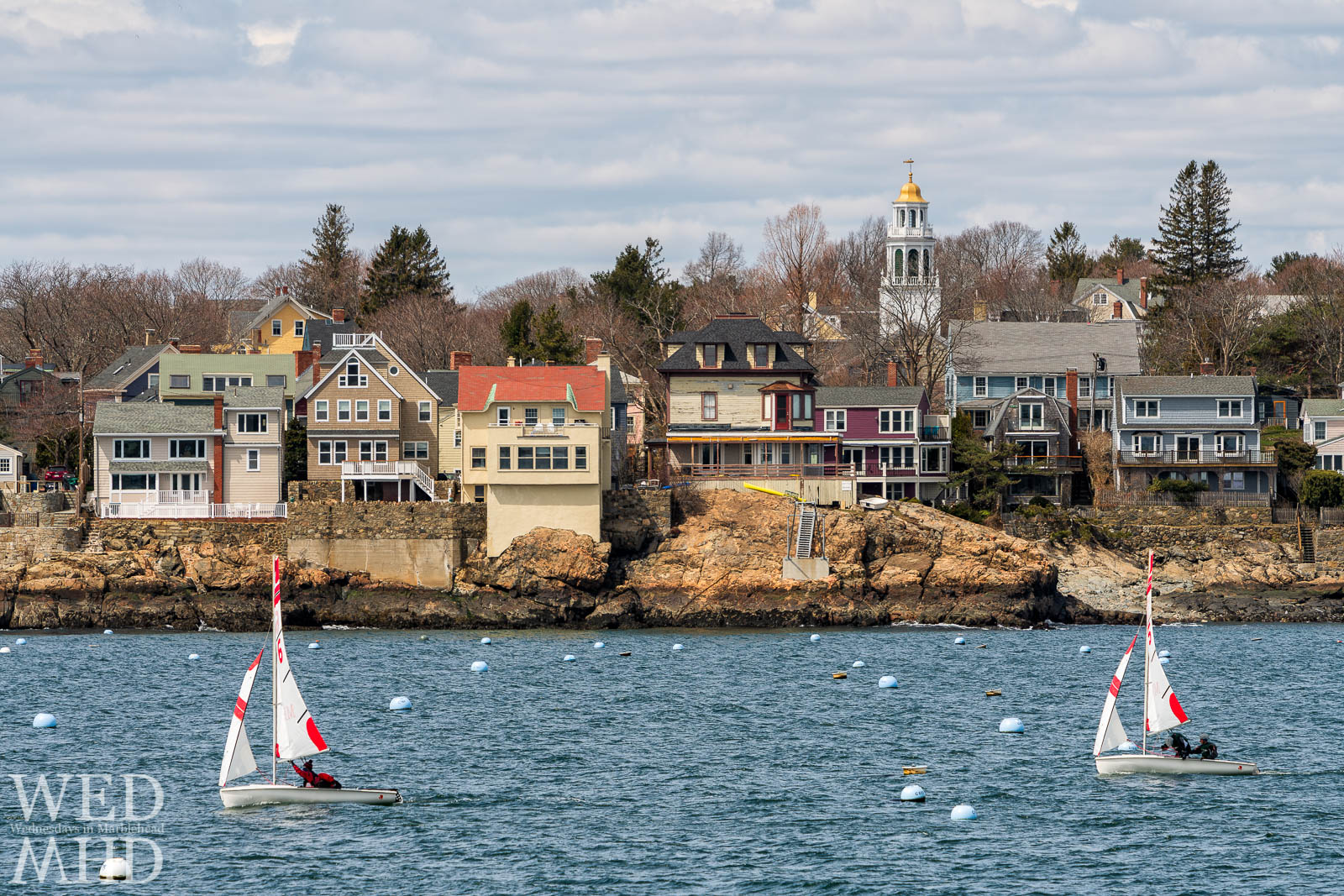 Frostbite sailing takes place each winter in Marblehead Harbor. Here two boats pass in front of the Old North Church