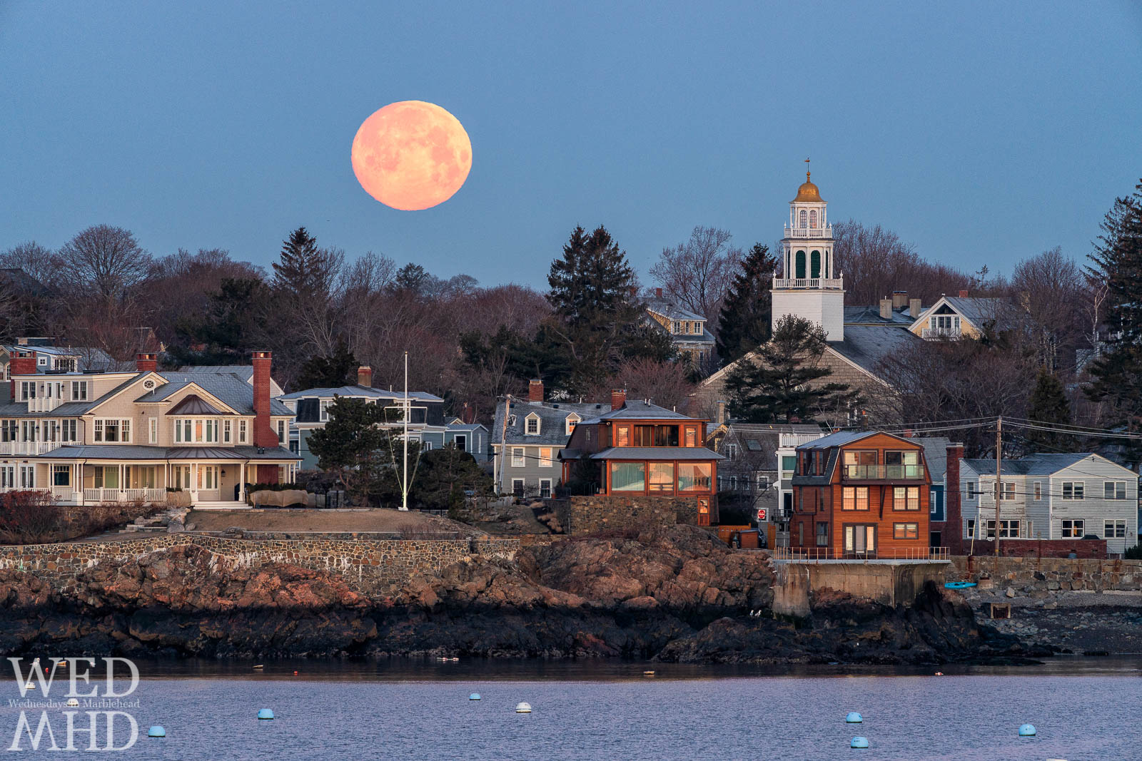 The full vernal worm moon sets beside Old North Church in Marblehead