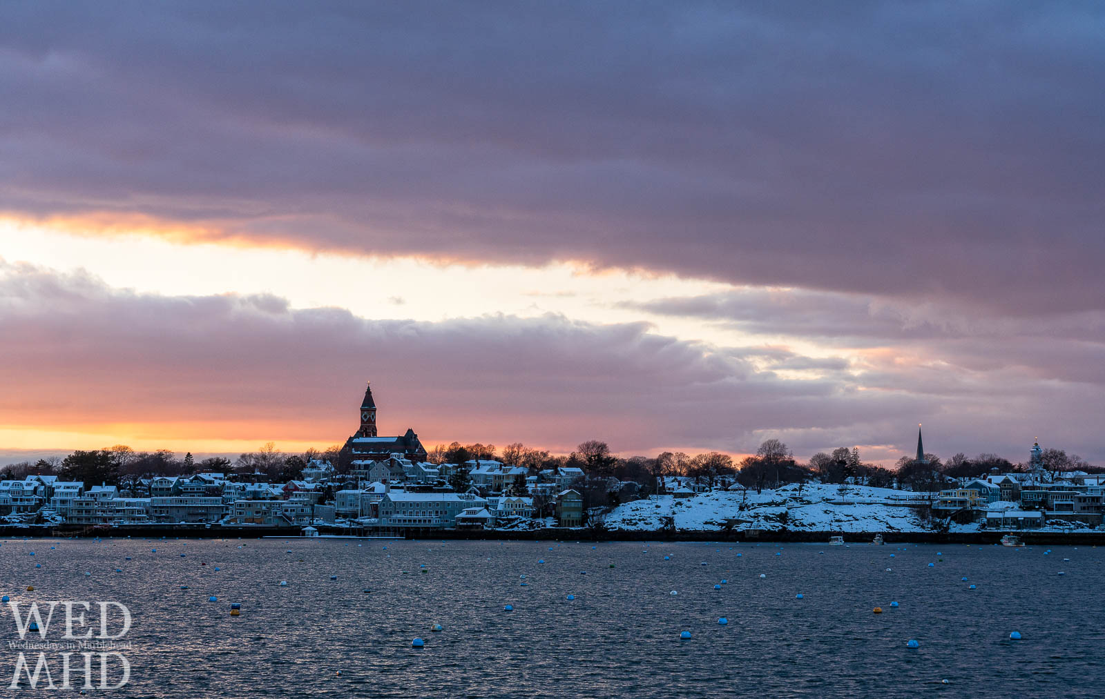 A beautiful sunset forms after a March storm dropped seven inches of snow on the town of Marblehead