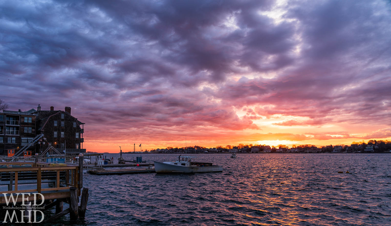 A beautiful sunrise captured from the State Street landing with Marblehead Harbor yet to fill with boats for the season