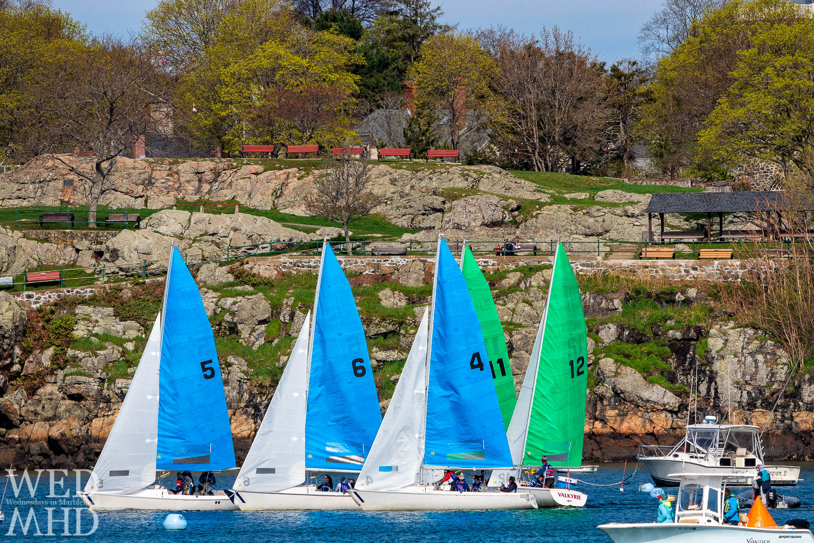The race for the Jackson Cup takes place in Marblehead Harbor with boats passing in front of familiar landmarks such as Crocker Park
