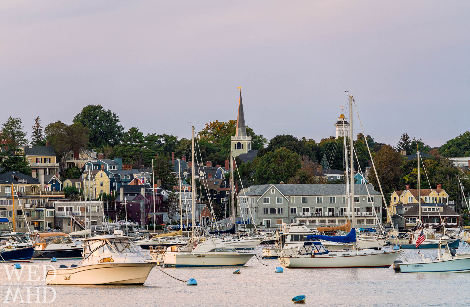 The view across Marblehead Harbor from this spot on Harbor Avenue captures a full house with boats filling nealy every mooring and colorful homes on the distant shore