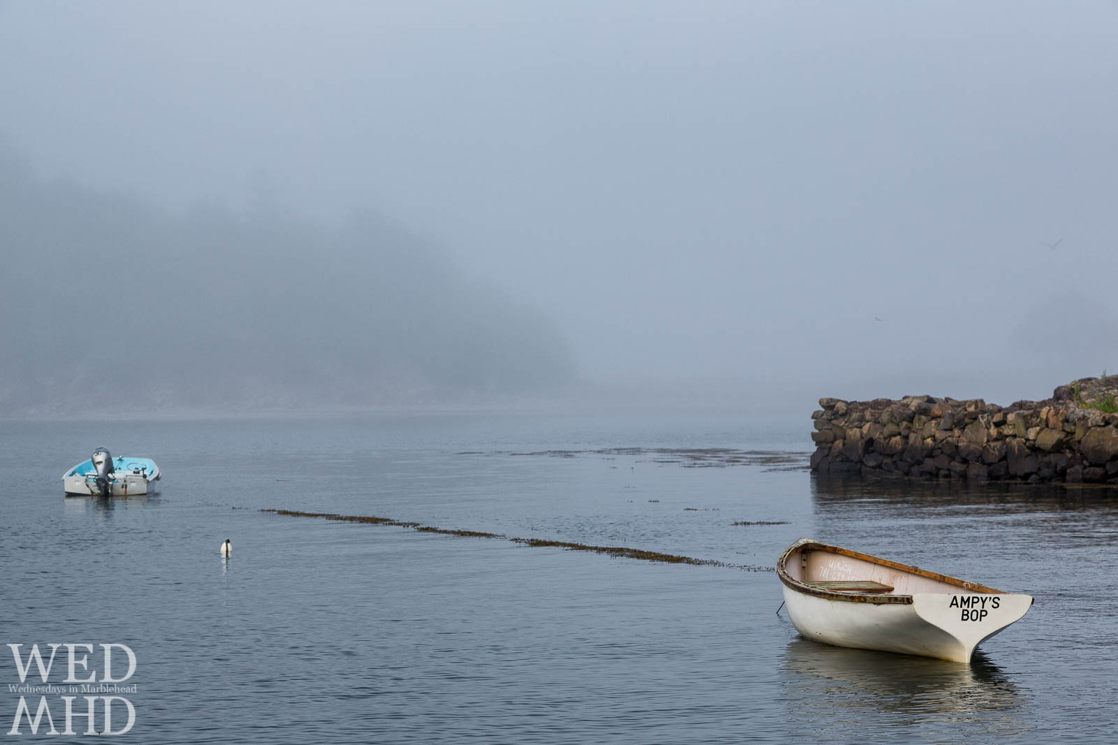 A small boat named Ampy's Bop is seen on a foggy Summer evening with Brown's Island barely visible in the distance