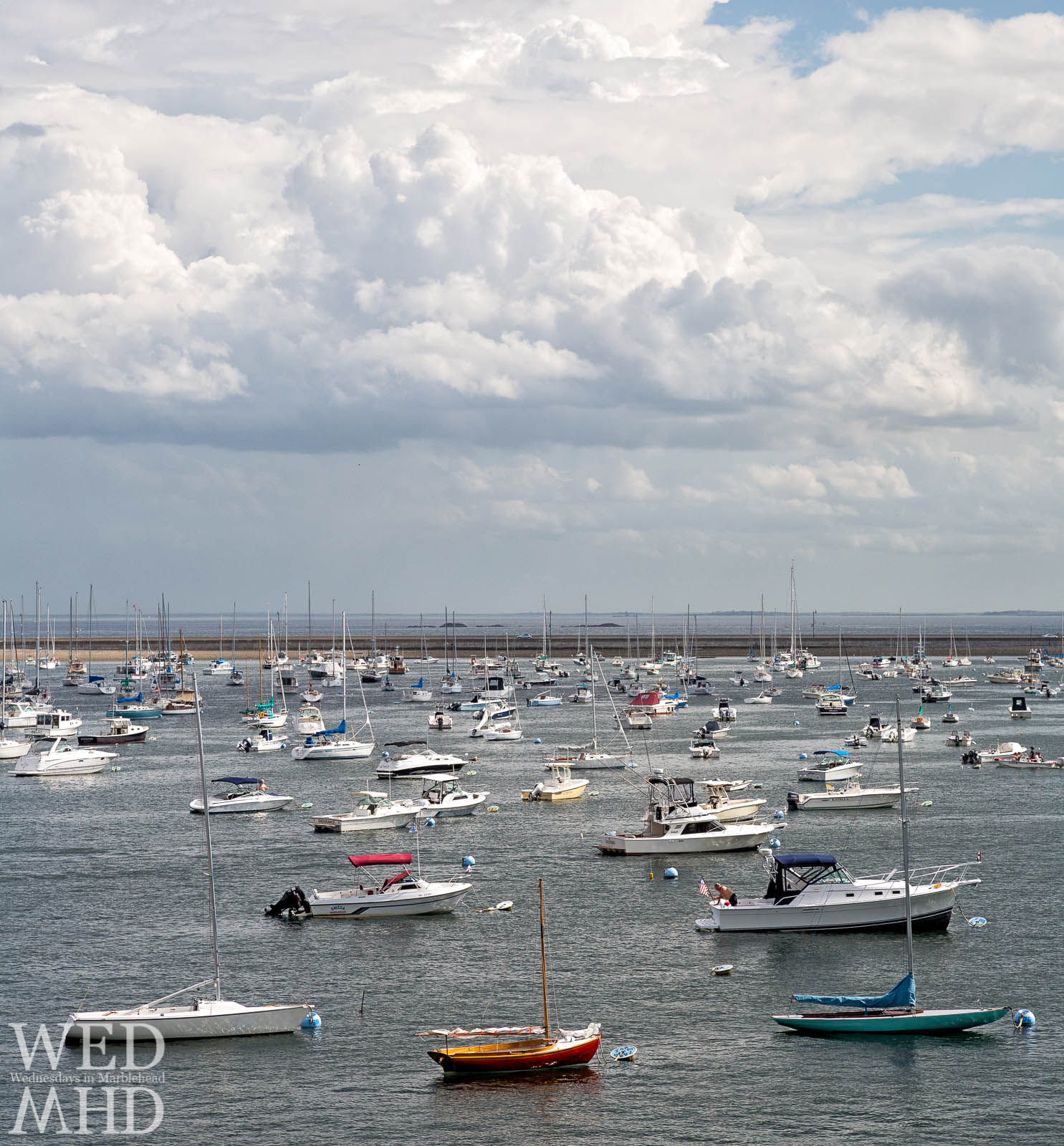 A view of boats morred in inner harbor looking out toward the causeway from Crocker Park in Marblehead