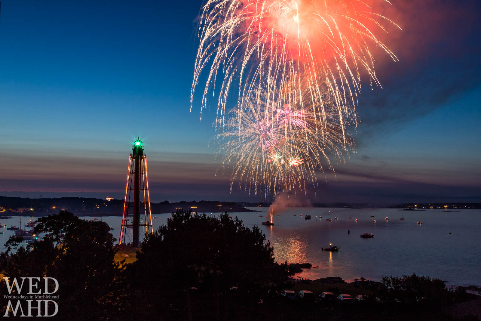Indepence day is celebrated with the annual Marblehead fireworks show as seen from a cupola looking down on Marblehead Light and a volley of explosions