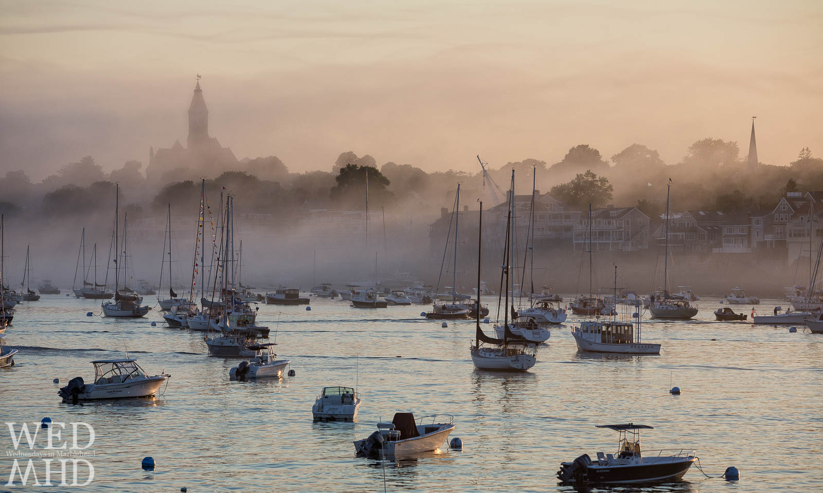 Fog rolls in on a July evening painting the harbor in incredible light