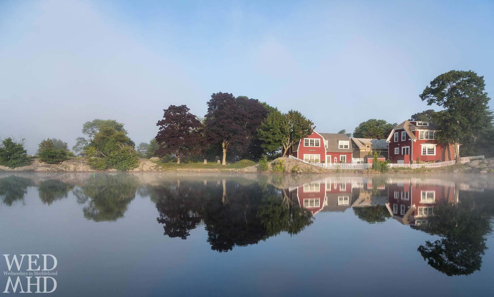 A soft fog creates a perfect mood for quiet reflections at Redd's Pond on a late July evening
