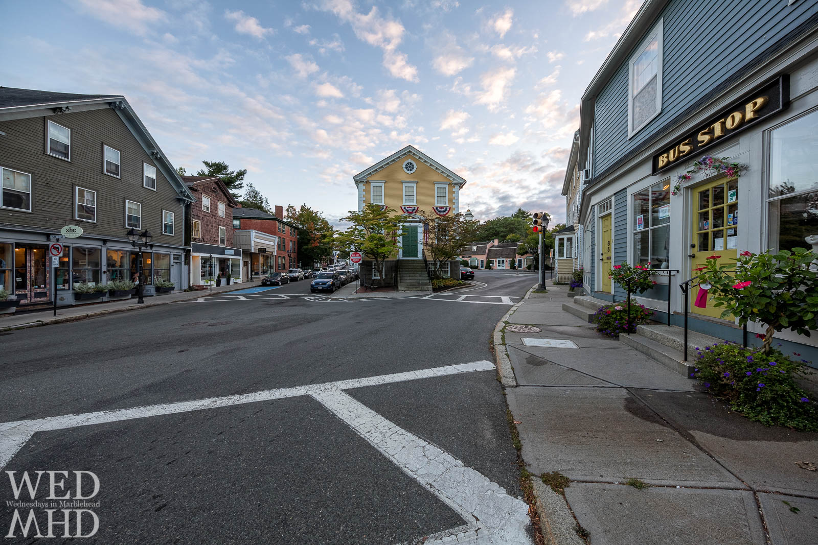 An ultra wide angle view of historic downtown Marblehead features Old Town House, She and The Bus Stop
