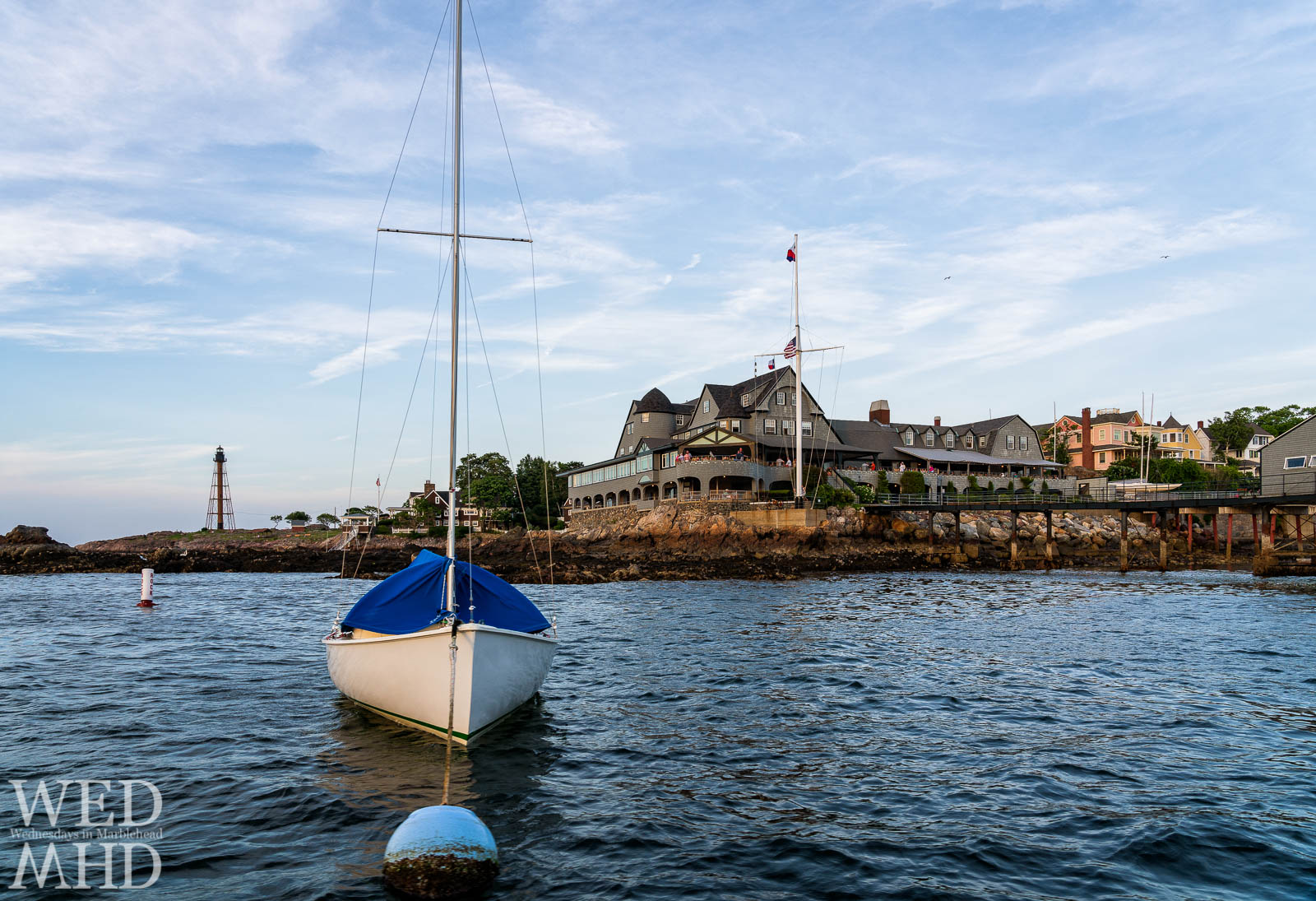 Cruising around Marblehead Harbor on a Friday evening and rounding the corner at the CYC to find this view of a boat on its mooring and the lighthouse standing tall at Chandler Hovey Park
