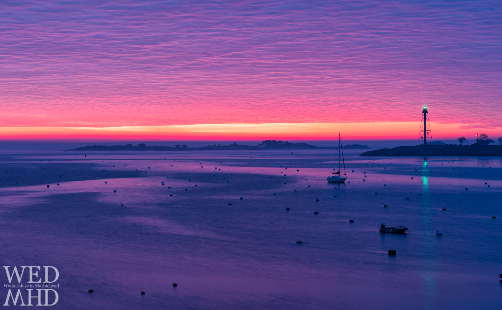 An early morning wakeup results in witnessing and capturing a corker of a sunrise with a loan boat in Marblehead Harbor bathed in purple light