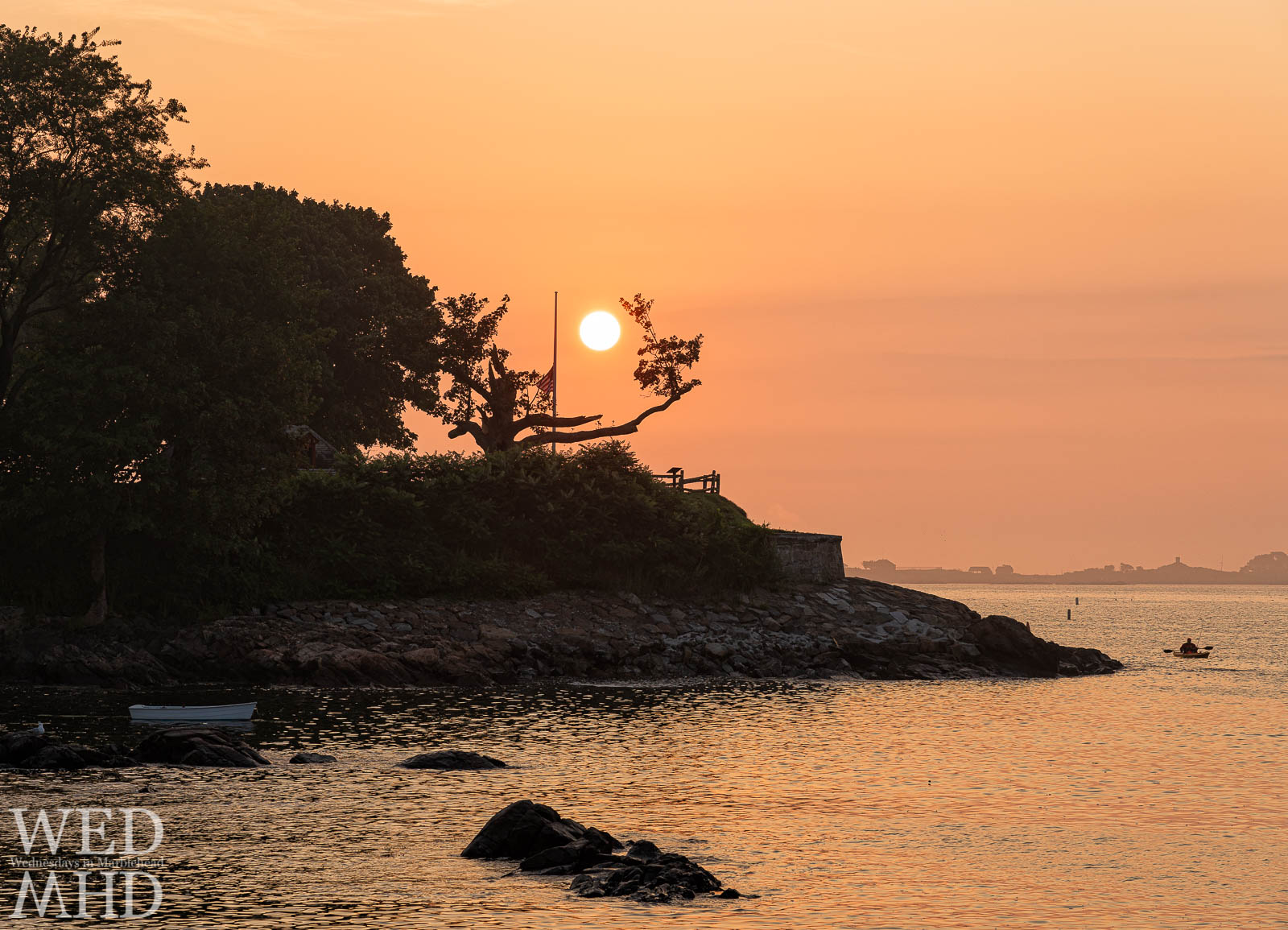 The sun rises over Fort Sewall and what remains of the Giving Tree on a humid summer morning in Marblehead