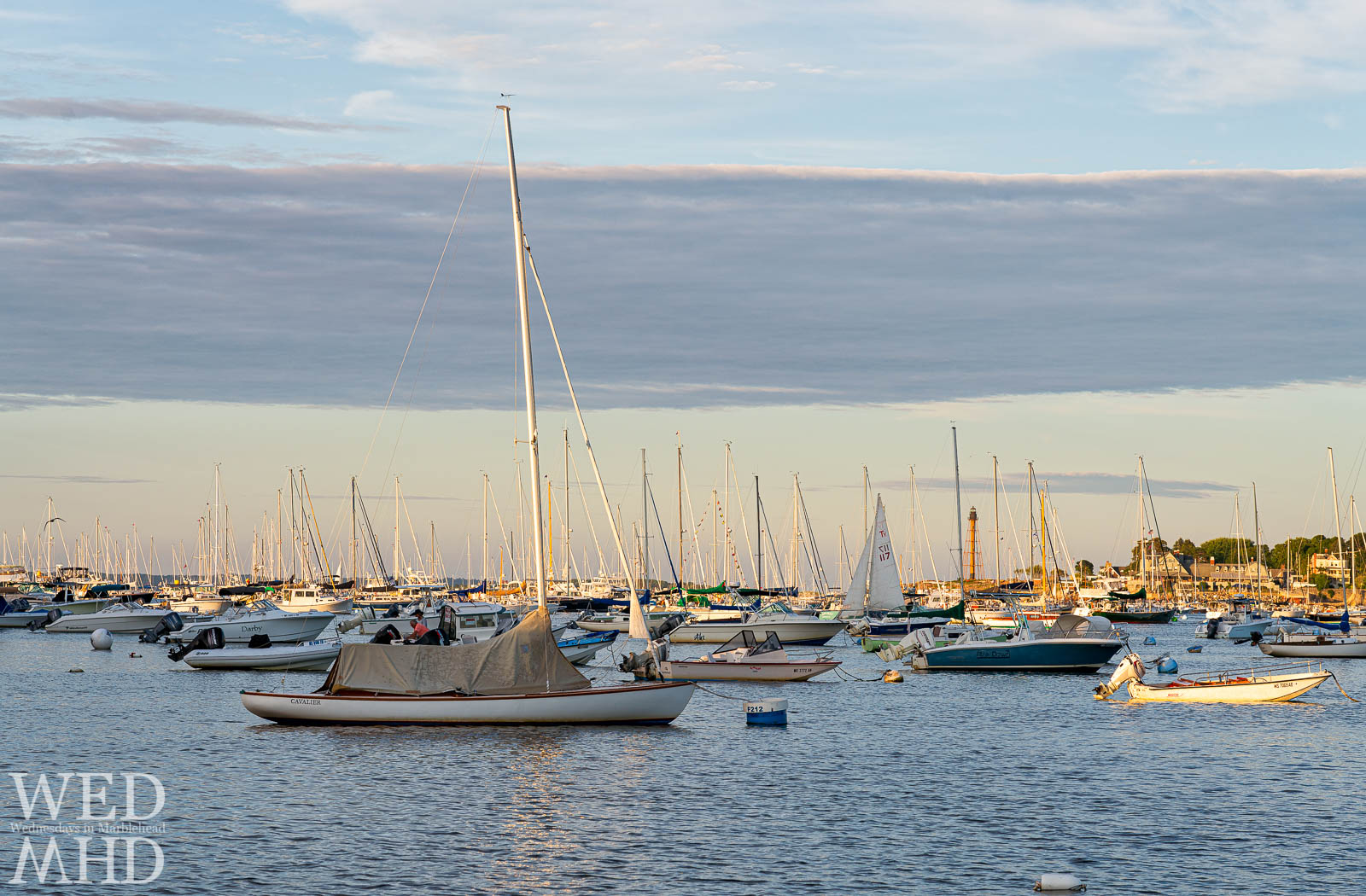 Golden sunlight reflects off boats filling Marblehead Harbor on this Labor Day weekend