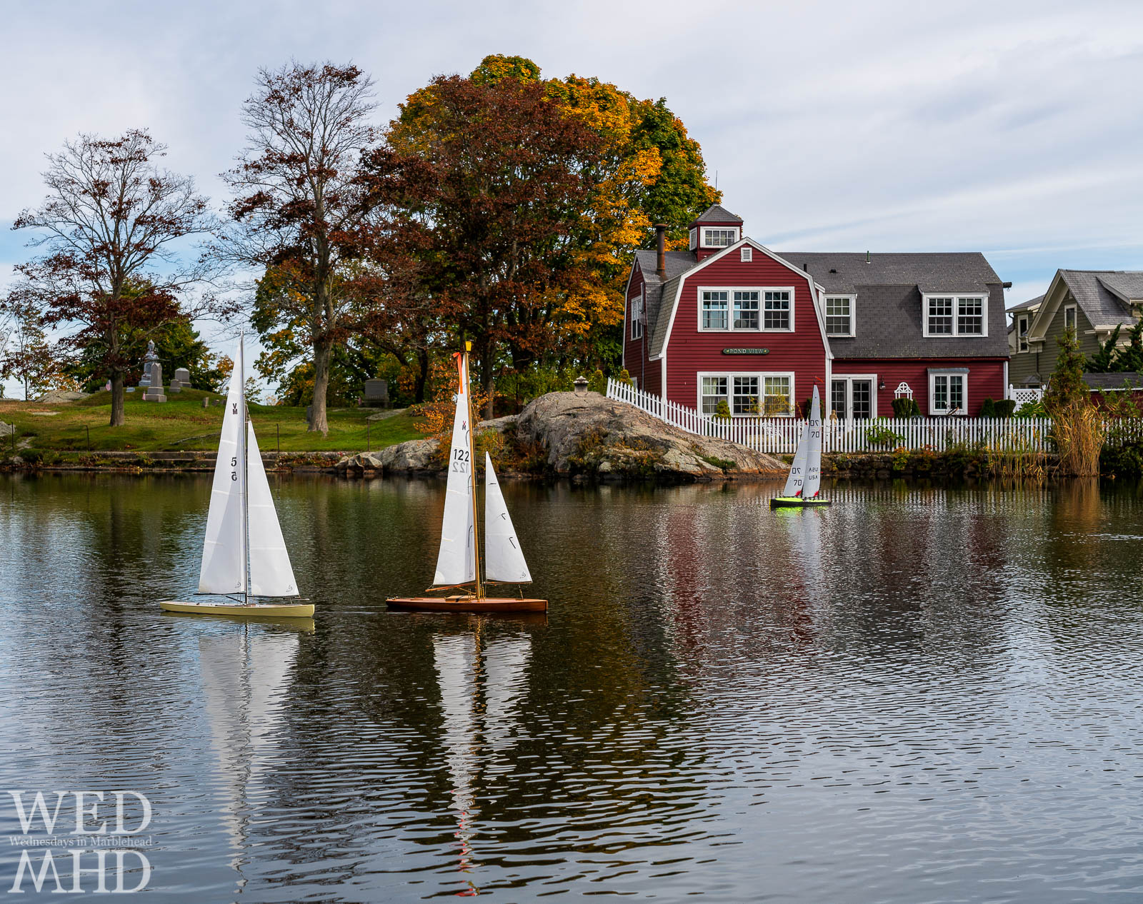 Foliage at Old Burial Hill sets the scene for the fall regatta at Redd's Pond with model sailboats cutting through the water