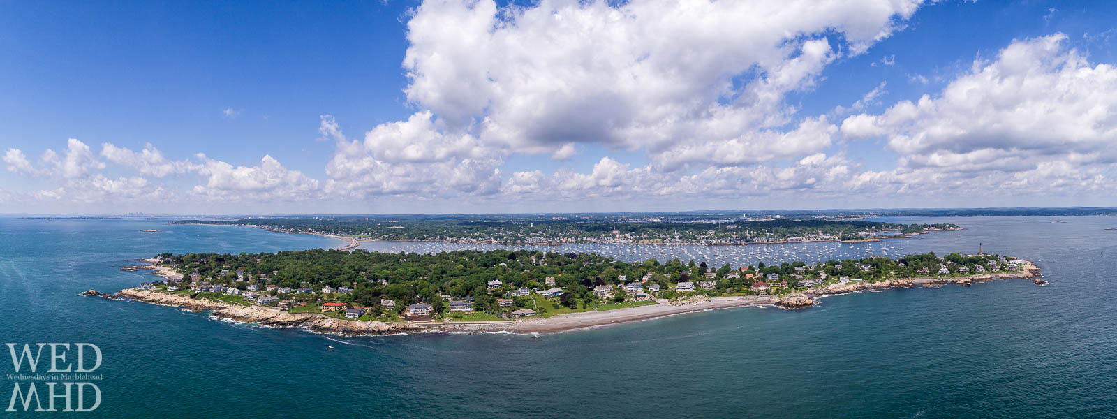 A panoramic view of Marblehead Neck and Harbor captured while flying the drone just off the coast