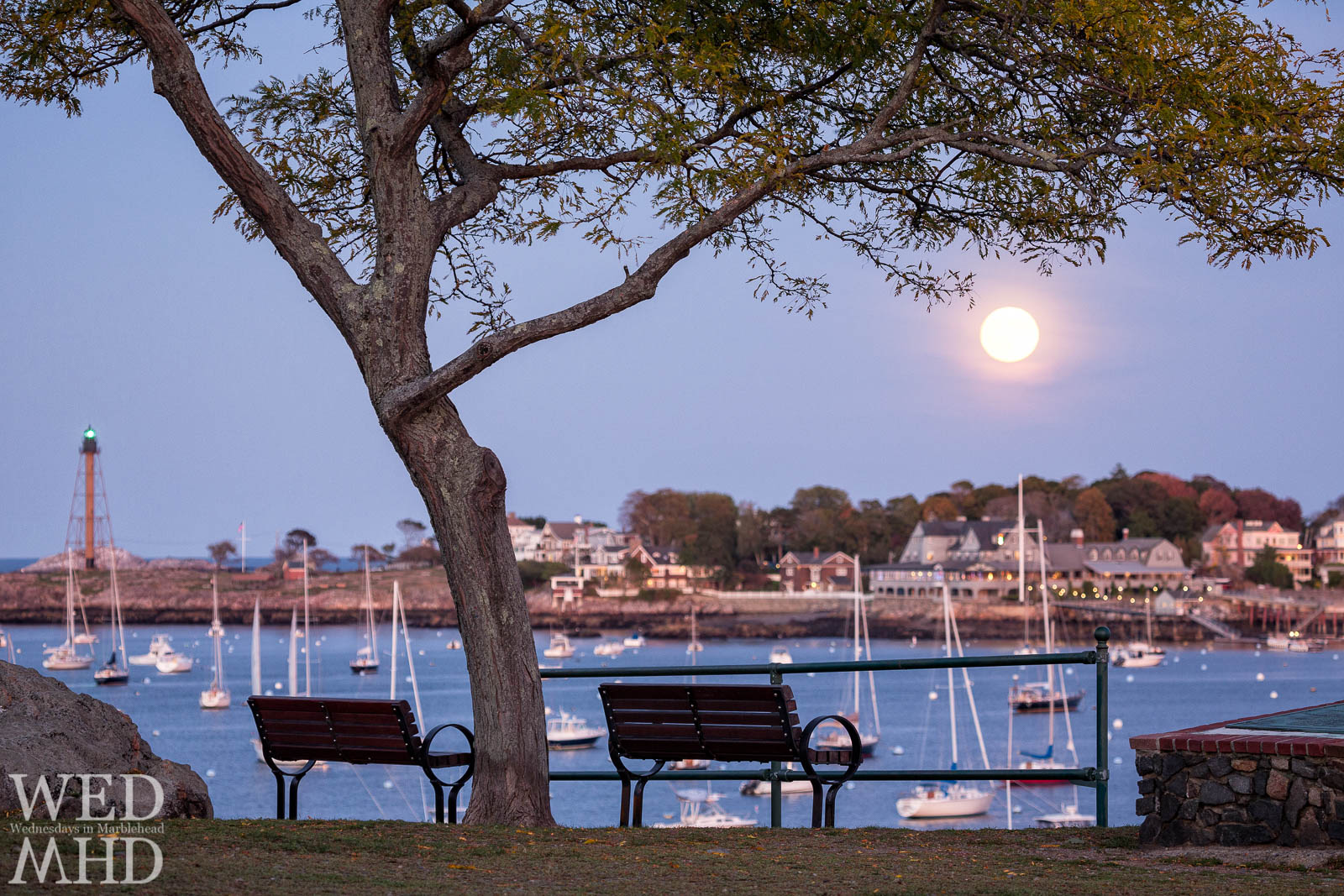 The full Hunters moon rises over the Eastern Yacht Club as seen from Crocker Park