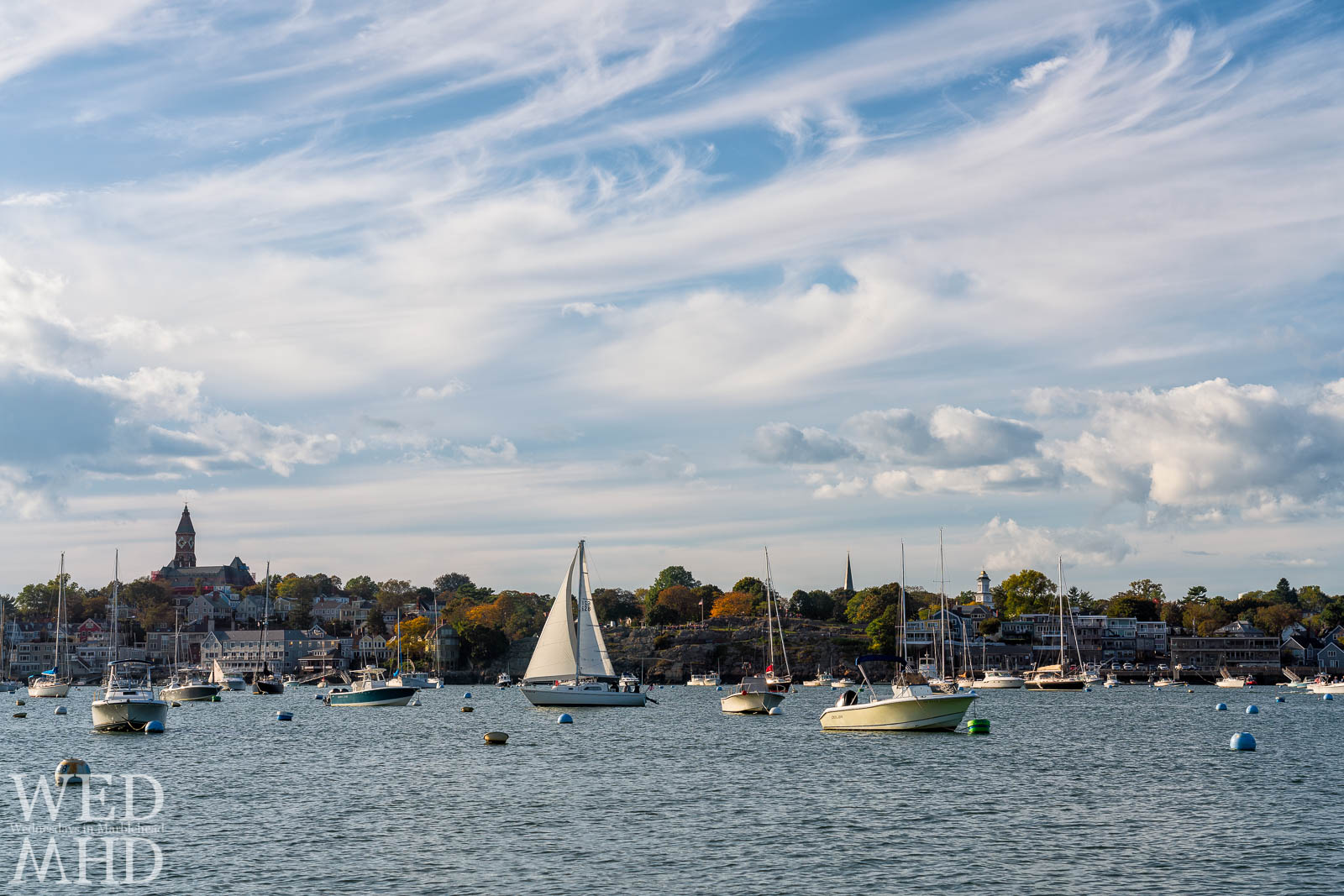 A boats heads back into Marblehead Harbor after an October Sail with crisp air and a strong breeze