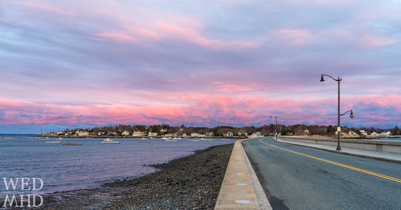 A beautiful Thanksgiving sunset lights up the sky above Marblehead Neck as seen from the edge of the causeway