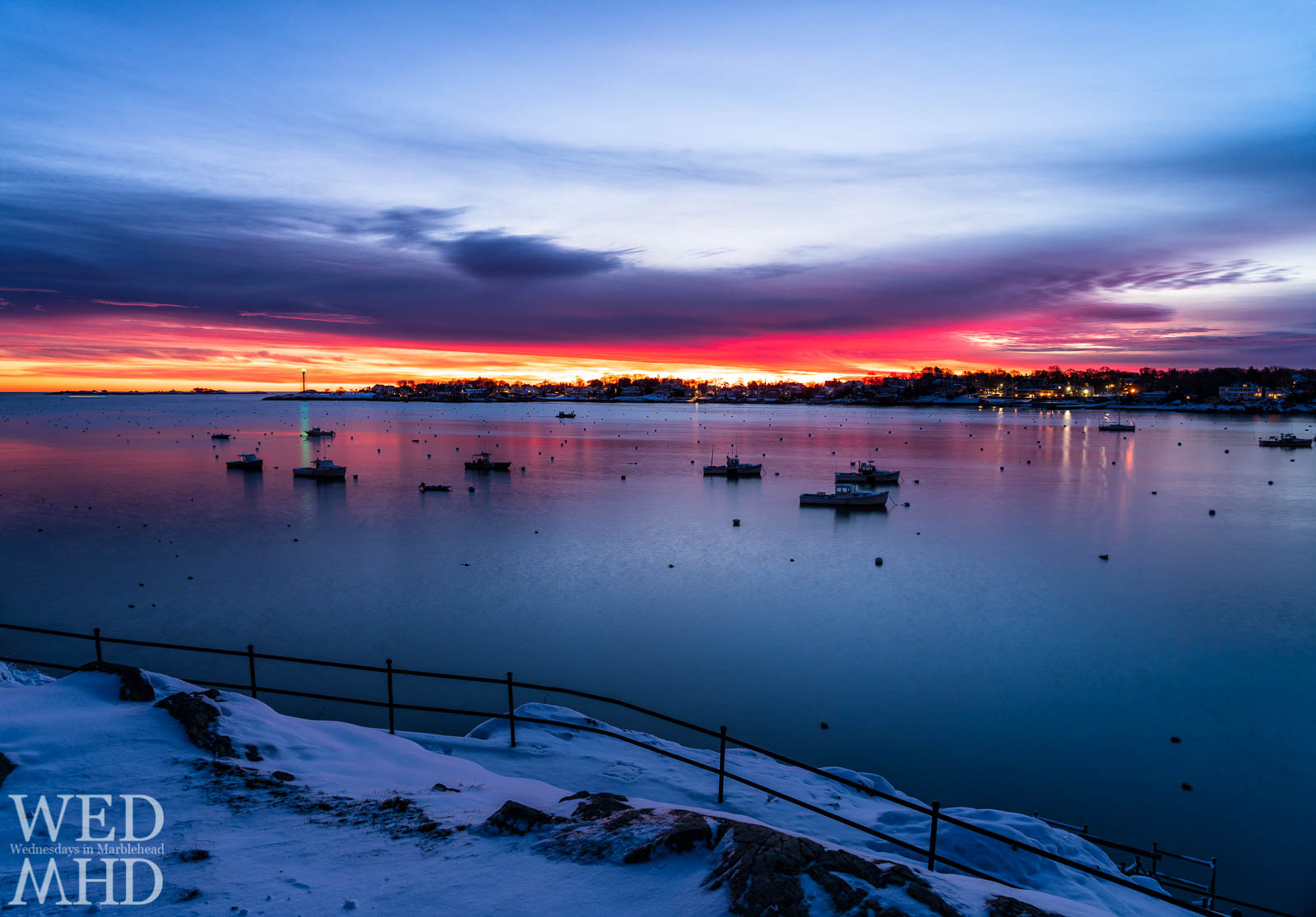 Newly fallen snow at Crocker Park offers the perfect setting for a fresh start to the day capturing the dawn breaking over Marblehead Harbor